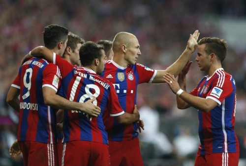 Bayern Munich's Lewandowski, Mueller, Bernat, Robben and Goetze celebrate goal during German Bundesliga first division soccer match against Wolfsburg in Munich