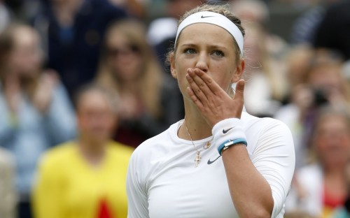 Victoria Azarenka of Belarus blows a kiss after defeating Maria Joao Koehler of Portugal in their women's singles tennis match at  the Wimbledon Tennis Championships, in London