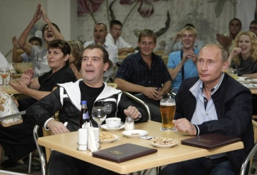 Russia's President Medvedev and Prime Minister Putin watch the international friendly soccer match between Argentina and Russia in Sochi
