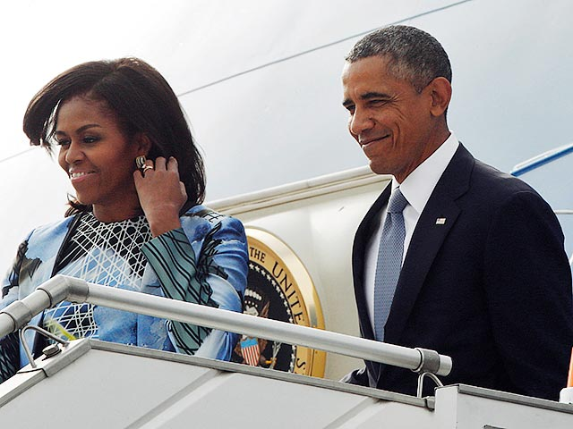 U.S. President Obama and first lady Michelle Obama arrive at Air Force Station Palam in New Delhi
