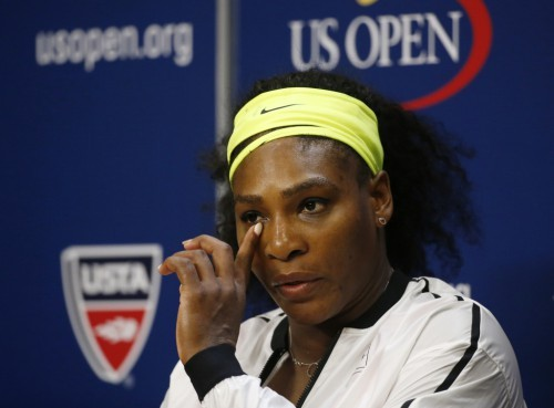 Serena Williams of the U.S. listens to a reporter's question during a post-match press conference following her loss to Roberta Vinci of Italy in their women's singles semi-final match at the U.S. Open Championships tennis tournament in New York, September 11, 2015. REUTERS/Shannon Stapleton (TPX IMAGES OF THE DAY) - RTSP86